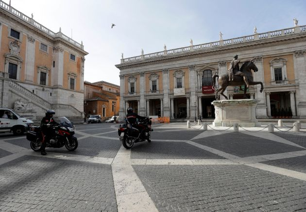 Italian paramilitary police ride their motorcycles in Piazza del Campidoglio Capitoline Hill next to...