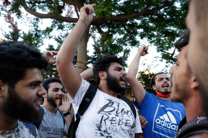 Anti-government protesters shout slogans in Beirut, Lebanon, Saturday, June 13, 2020. Lebanese protesters took to the streets