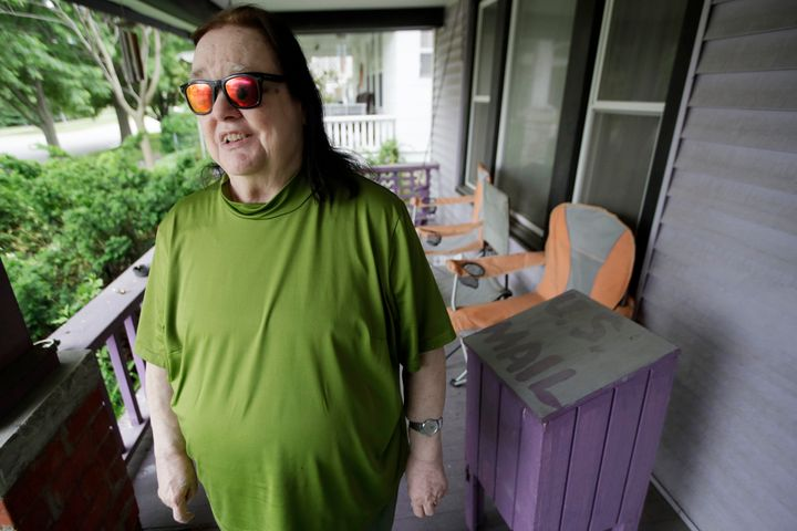 In this Wednesday, May 27, 2020, photo, Ann Byington stands next to the mail box at her home in Topeka, Kan. Blind voters like Byington fear a loss of control over their ability to cast a ballot as election officials across the U.S. plan a major expansion of voting by mail amid the coronavirus pandemic. (AP Photo/Orlin Wagner)