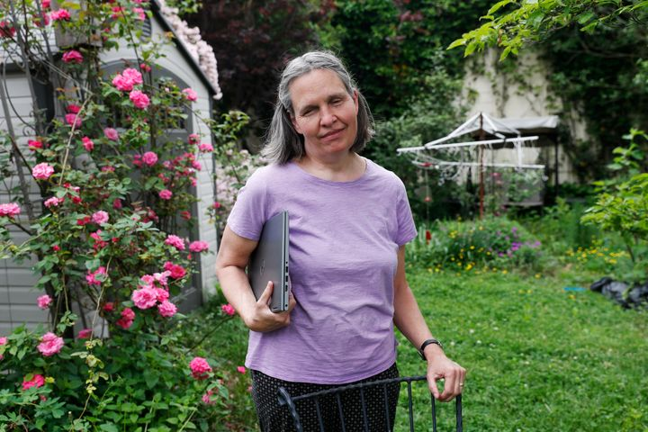 In this May 28, 2020, photo, Tracy Carcione, a 59-year-old computer programmer who is blind, poses for a photograph at her home in Teaneck, N.J. Blind voters fear a loss of control over their ability to cast a ballot as election officials across the U.S. plan a major expansion of voting by mail amid the coronavirus pandemic. (AP Photo/Kathy Willens)