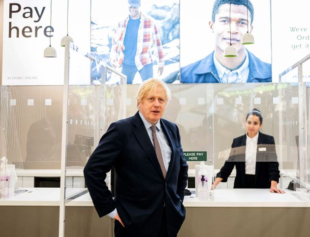 Britain's Prime Minister Boris Johnson visits a shop in Westfield Stratford shopping centre in east London,...