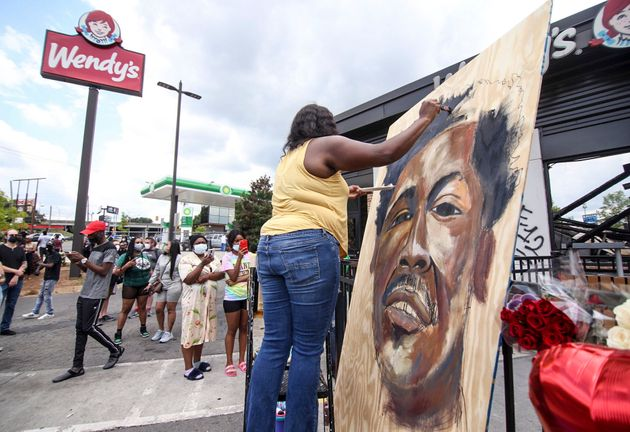 Ashley Dopson paints a picture of Rayshard Brooks in the parking lot of the Wendy's in Atlanta where...