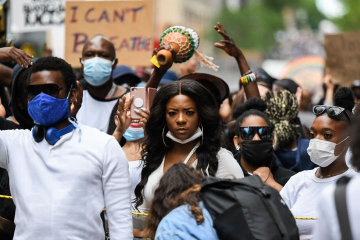 Protesters march against police brutality and racism in Montreal on June 7.
