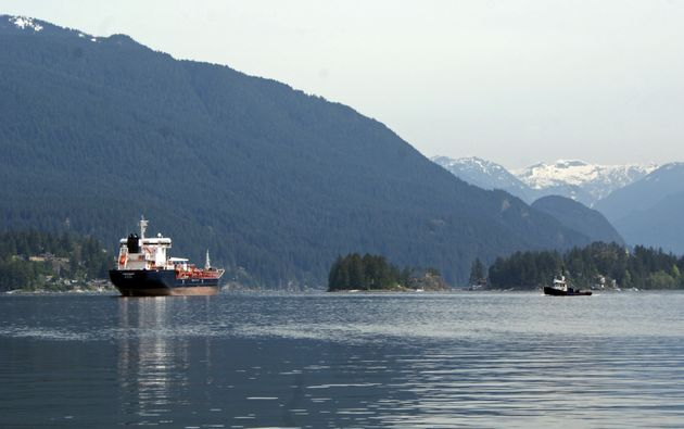 This May 3, 2018 photo shows the Kirkeholmen oil tanker anchored outside the Kinder Morgan Inc. Westridge...