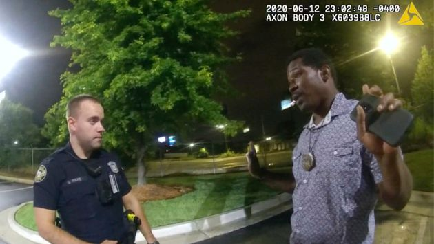 This screen grab taken from body camera video provided by the Atlanta Police Department shows Rayshard...