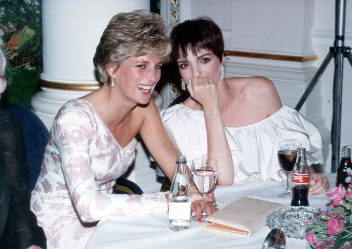 "Diana, Princess of Wales, laughs with Liza Minnelli at a party following the charity film premiere of ""Stepping Out"" on Sep."