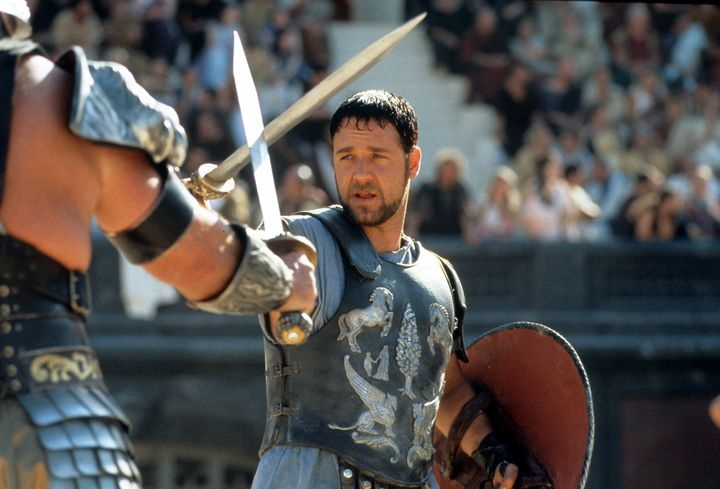 "Russell Crowe facing off in a scene from the film ""Gladiator."""