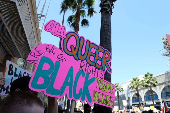 "A sign reading ""All queer right are because of Black trans women"" is seen at the All Black Lives Matter Solidarity March on Sunday in Los Angeles."