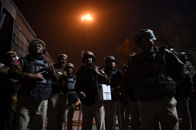 Police patrolling a riot-hit area in New Delhi on February 25,