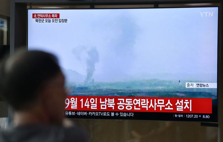 A television news screen shows an explosion of an inter-Korean liaison office in North Korea's Kaesong Industrial Complex.