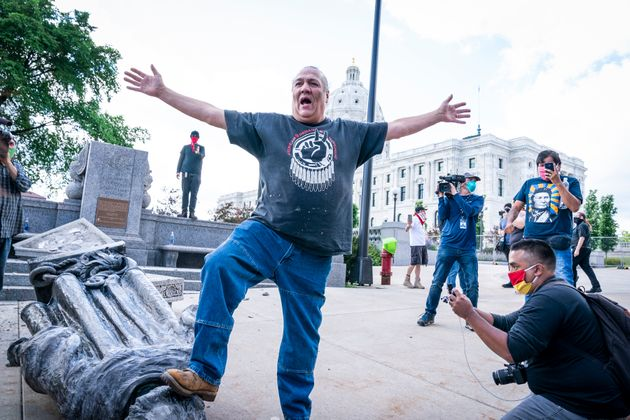 Mike Forcia, of the Black River Anishinabe, celebrated after the Christopher Columbus statue was toppled...