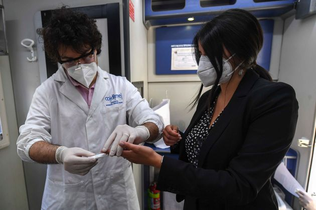 NAPLES, CAMPANIA, ITALY - 2020/06/15: A health worker carries out a coronavirus (Covid-19) rapid test...