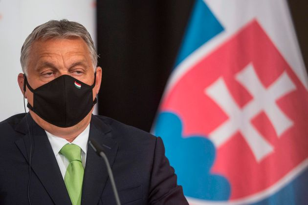 (FILES) In this file photo taken on June 11, 2020 Hungary's Prime Minister Viktor Orban addresses a joint...