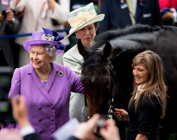 Princess Anne looks on as Queen Elizabeth II pats her Gold Cup winning horse Estimate on Ladies Day of Royal Ascot on June 20