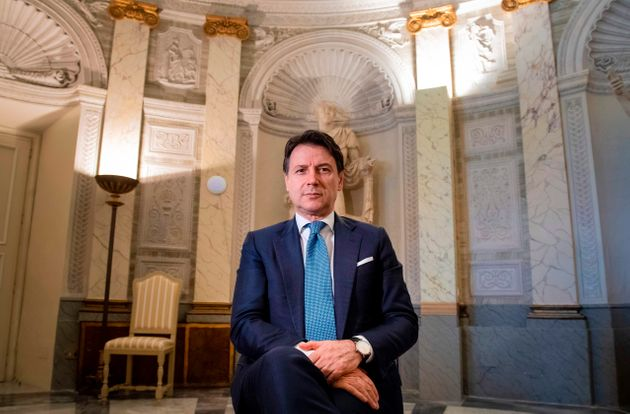 Italy's Prime Minister Giuseppe Conte poses within an interview with AFP at Villa Pamphilj in Rome on...