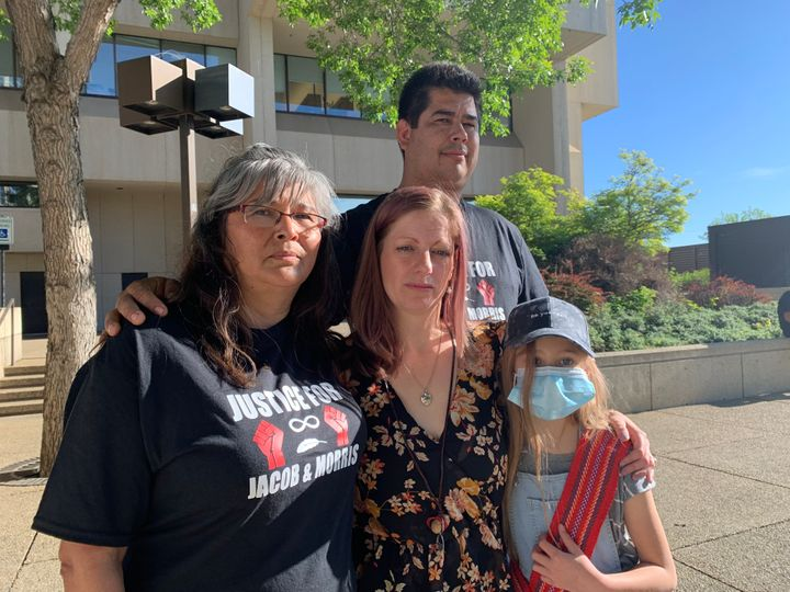 From left to right: Michael Sansom in the back, Ruby Smith, left, Sarah Sansom, centre, and her daughter were at the Edmonton courthouse on Tuesday to oppose the bail request by the accused.