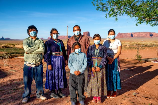 A Navajo family wears masks to protect against the spread of COVID-19 in Monument Valley,