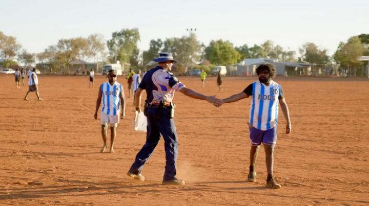 Senior Sergeant Revis Ryder coaches the local footy team in Warakurna.