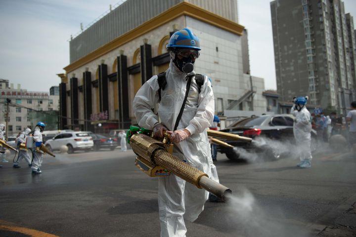 Workers disinfect the Yuegezhuang wholesale market in Beijing on June 16, 2020, following a coronavirus outbreak.