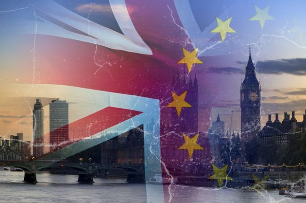 No Deal Brexit concept image of cracks over image of London with UK and EU flags in