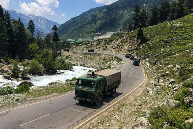 An Indian army convoy makes way towards Leh on June 17,