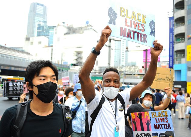 Supporters of Black Lives Matter Tokyo protest against racism and police violence in Tokyo on Sunday,...