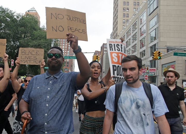 Activists in New York City before marching to Times Square to protest the police-involved shootings of Philando Castile and Alton Sterling in 2016.