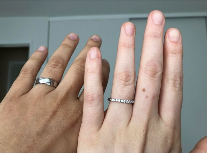 The author and her fiancée,Kristina, display their engagement/wedding bands.