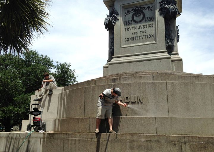 In this June 23, 2015, file photo, Joe Patrizzi III power-washes graffiti from a statue in Charleston, South Carolina, of Joh
