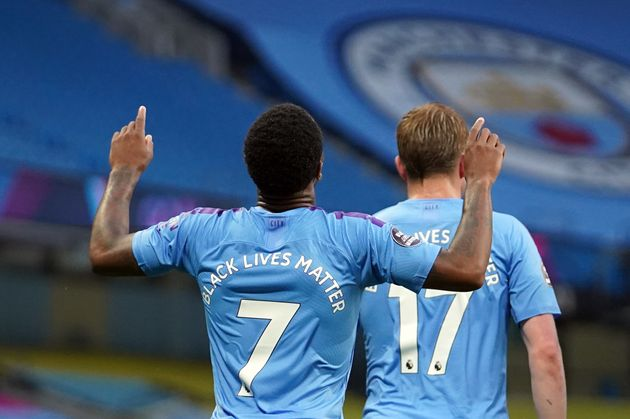 Manchester City's Raheem Sterling celebrates scoring the opening goal during the Premier League match...
