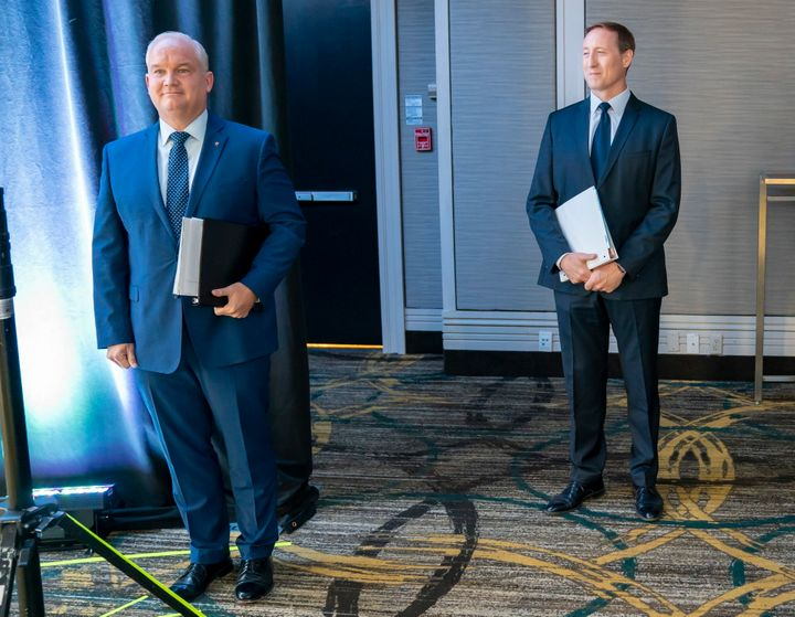 Conservative Party of Canada leadership candidates Erin O'Toole and Peter MacKay wait for the start of the French Leadership Debate in Toronto on June 17, 2020