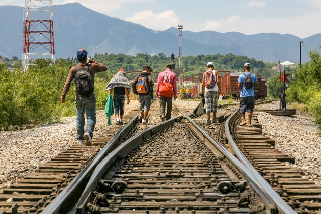 Coahuila, Mexico, Jun 16 - A group of migrants of Central American origin waits on the railway line to...