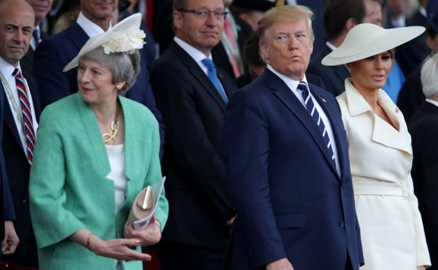 Then-prime minister Theresa May with Donald Trump and Melania Trump during the commemorations for the...