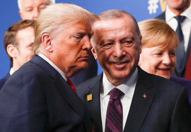 Donald Trump with Turkey's President Recep Tayyip Erdogan at the NATO summit, with German Chancellor...