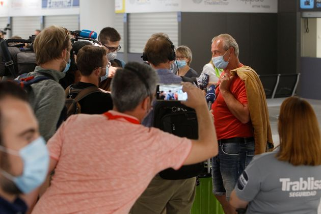 Travelers from Germany speak to the press upon arrival at Palma de Mallorca Airport on June 15, the day...