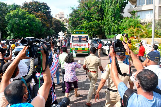 Media seen as an ambulance carrying the body of actor Sushant Singh Rajput is leaves his residence in...