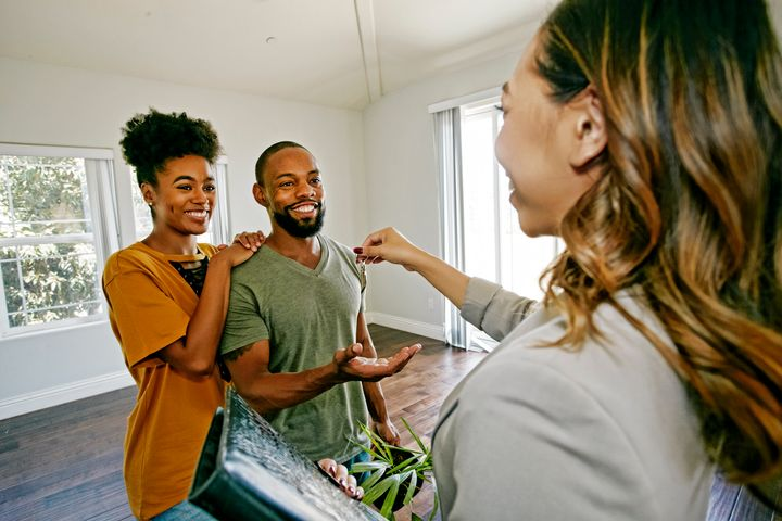 A young couple receives the keys to their new apartment in this undated stock photo. Some provinces have programs available specifically intended to help first-time homebuyers enter the housing market.