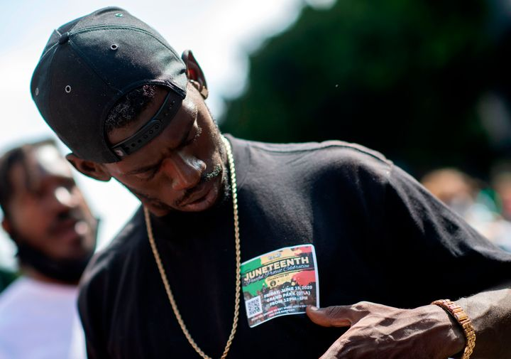 A man wearing a Juneteenth sticker during a demonstration calling for the removal of District Attorney Jackie Lacey in Los An