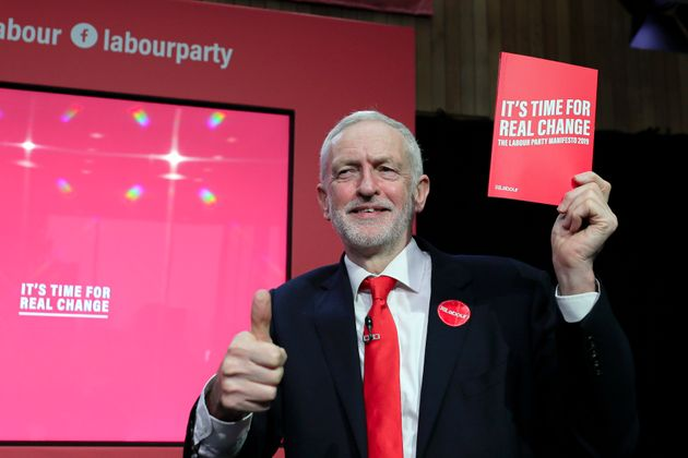 Jeremy Corbyn, former leader of the Labour Party, gives a thumbs up holding a copy of the 2019