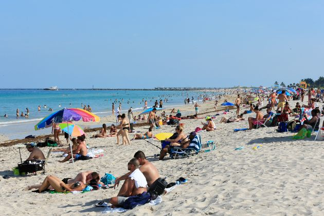 Beachgoers at the opening of South Beach in Miami Beach, Florida, on June 10. Public health experts are...