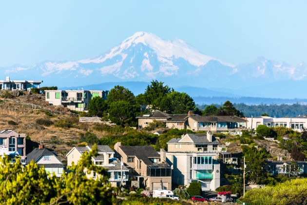 Single-family homes in Victoria, B.C., with Mount Baker, in Washington state, in the background. A large...