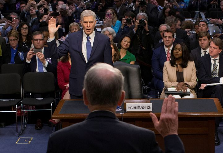 Mary Elizabeth Taylor, right, observes as Senate Judiciary Committee Chairman Chuck Grassley (R-Iowa) swears in Neil Gorsuch