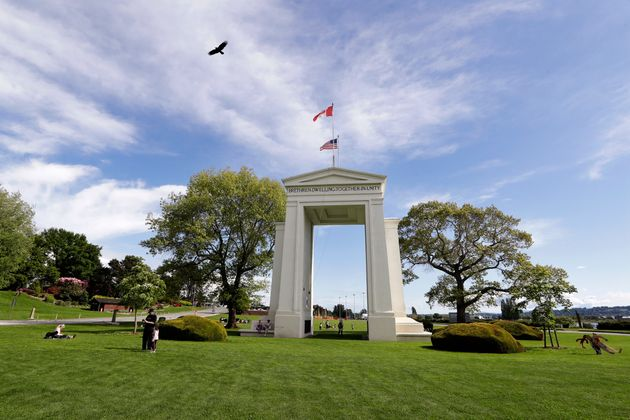 In this May 17, 2020 file photo, a bird flies from the U.S. into Canada over the Peace Arch in Peace...