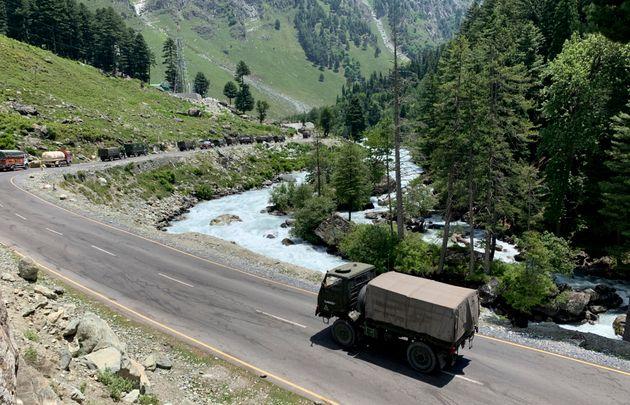 An army convoy moves on the Srinagar- Ladakh highway at Gagangeer, north-east of Srinagar, June 18,