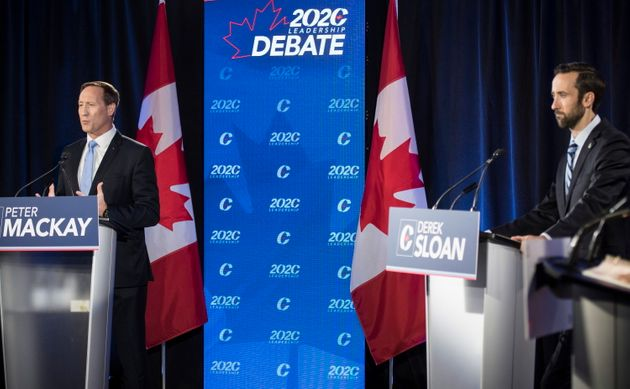 Conservative Party of Canada leadership candidates Peter MacKay, left, and Derek Sloan participate in...