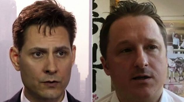 Michael Kovrig, left, is photographed in 2018, while Michael Spavor is seen beside him in a photo taken...