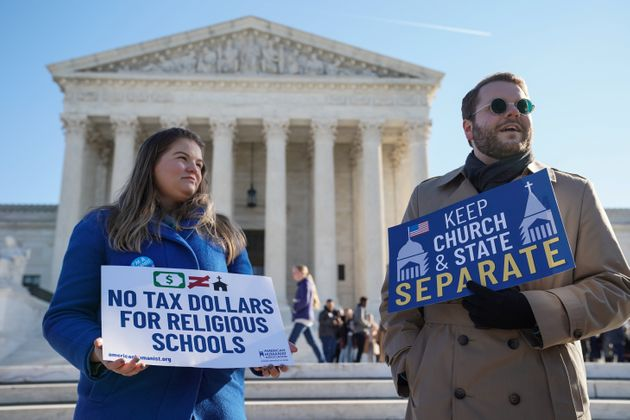 People gather outside the Supreme Court during oral arguments in the Espinoza v. Montana Department of...
