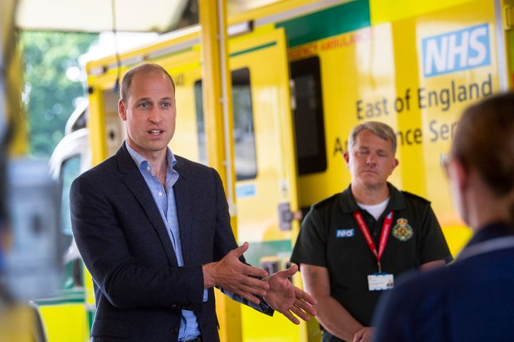 Prince William meets paramedic staff while maintaining social distancing during a visit to the ambulance station in King's Ly