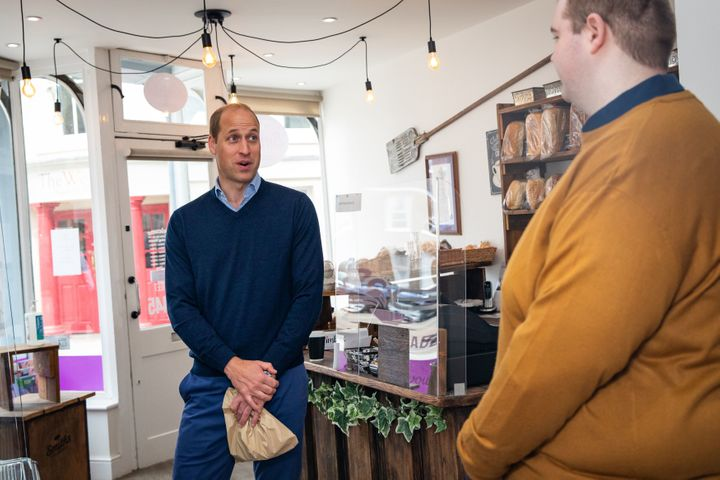 William speaks to staff member Ted Bartram during a Friday visit to Smiths the Bakers in King's Lynn.