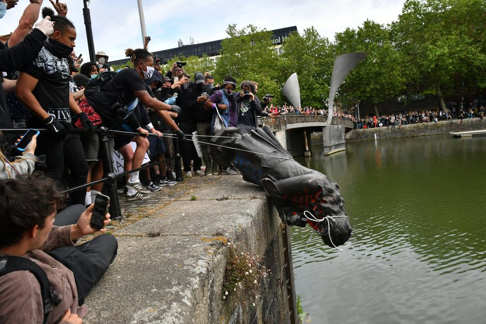 Protesters throw the statue of Edward Colston into Bristol harbour during a Black Lives Matter protest...